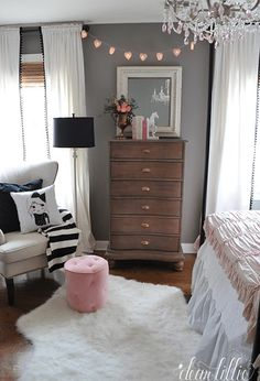 girls bedroom with chocolate brown dresser, benjamin moore french press, dark wood dresser, white sheepskin rug, pink accents, purplish-gray wall paint, black and white striped blanket