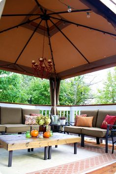 Covered outdoor gazebo with fall decor