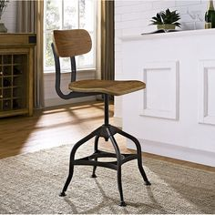 Bar stool have a full 360 degree swivel and features solid construction with a modern wood finish.  Ideal for an industrial or rustic inspired dining room, kitchen or living room. The round seat is adjustable, it can work with a counter height table or a pub table.