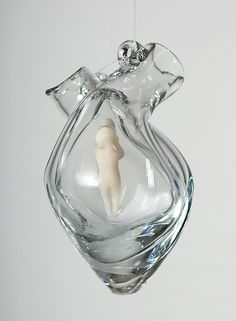 """Heart chamber: Listening"" 2010, 8""x5""x6"", clay in artist-designed glass vessel. (in private collections)  Vessel hand blown according to artist's maquette by John Burchetta; photo by William Nettles"