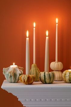Autumnal taper holders made of real pumpkins and gourds. - TownandCountrymag.com