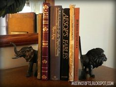 21 Ways to Create Your Own Bookends- Plastic animals and spray paint