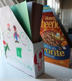 Now how cute is this??? Cereal boxes covered and decorated by your kids for organizing paper. FUN!