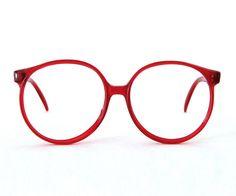 oversized round eyeglasses / translucent red frames