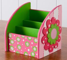 A bright color palette combined with a surface with a purpose makes a sweet desk organizer sweet enough for any young ladies bedroom! Wood surface found at Walmart. #folkart paint #folkart #crafts #plaid crafts #walmart