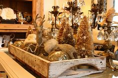 tray filled with ornaments and bottle brush trees
