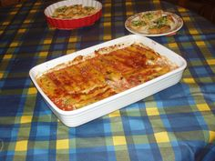 cannelloni filled with ricotta, eggs and spinach and covered with tomato and meat sauce+parmesan cheese