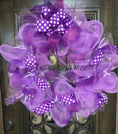 Lavender, Purple with White Polka Dot Ribbon. Measures about 34 inches in diameter Due to the higher cost of shipping this large wreath, we are only allowing t