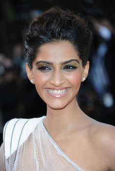 Pin for Later: 21 Times We Were Bowled Over by the Beauty of Sonam Kapoor 2011 Sonam's olive shimmery eye makeup for The Artist inspired us to try a more colorful shadow shade.