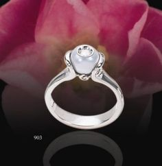 This is a Galetea diamond in a pearl ring.  The one I have is in yellow gold.  It's beautiful.