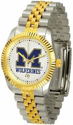 Michigan Wolverines UM NCAA Mens Steel Executive Watch by SunTime. $133.95. Stainless Steel. 23kt Gold-Plated Bezel. Links Make Watch Adjustable. Men. Officially Licensed Michigan Wolverines Men's Two Tone Gold Dress Watch. The ultimate fans statement our Mens Executive Watch timepiece offers men a classic business-appropriate look. Features a 23kt gold-plated bezel stainless steel case and date function. Secures to your wrist with a two-tone solid stainless steel band compl...