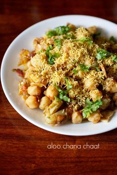 Aloo Chana Chaat Recipe - Spicy, tangy, sweet chaat recipe made with boiled potatoes and white chickpeas.