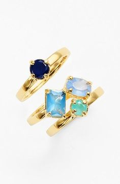 The blue and gold stone rings will create an elegant stacked style.