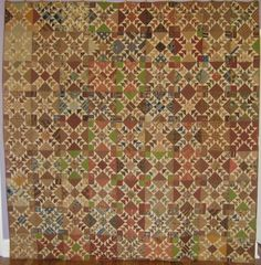 "An amazing mid 1800's quilt in a pattern called ""Odd Fellows"".  Beautiful brown, prussian blue and green fabrics can be found in the quilt."