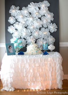 """I'm so glad I thought to try a doily snowflake, because it added the perfect Frozen touch,"" Megan said. DIYers can attempt to make their own, and everyone else can get the premade Pepper Lu Wonderland Backdrop ($60). Source: Genie Leigh Photography"