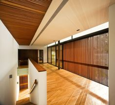 Architecture:Modern Curvilinear Pavilion Wood Blind Ceiling Glass Door Bay Window Staircase Basic Light Brown Textured Flooring Ege Seramik Modern House Design with Curvilinear Pavilion Blending in with the Natural Landscape