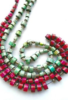 paper-bead-necklaces Mrs Warhol is a double strand of bright, elongated beads…