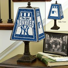 "MLB New York Yankees 14-Inch Art Glass Lamp by The Memory Company. $49.99. Brass-based resin base.. 14.5"" x 7 3/8"" Art Glass Table Lamp. Featuring team colors and logos.. Hand-painted art glass.. Here's a beautiful addition to our popular lighting collection - a 14-inch table lamp with its hand-painted glass shade sporting team colors and logo! Classic in design, this elegant lamp sits on a brass-based resin stand and will be a lovely accent to any decor, in any room."