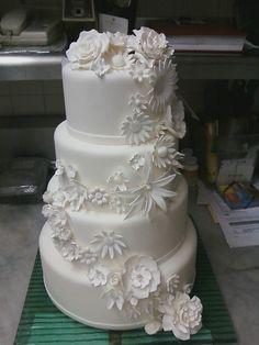Exquisite flowers cascade down this all white wedding cake Wedding Cakes With Flowers, Elegant Wedding Cakes, Beautiful Wedding Cakes, Cake Bouquet, Tropical Weddings, All White Wedding, Wedding Inspiration, Wedding Ideas, Diy Cake