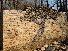 stone tree scalpture on wall