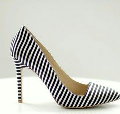 Forever 21 Pumps This chic, vertical striped pointy-toed pair of pumps is a stunner. Wear it with a pencil skirt or cigarette pants. Very good condition. Inside requires a little spot cleaning. Slight wear on the heel (as pictured). Forever 21 Shoes Heels