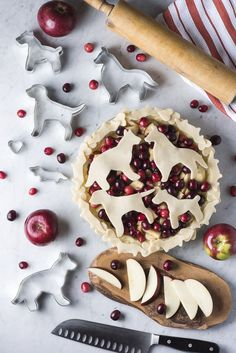 dog themed pies, flatlay, pie crust cookie cutters, apples, cranberry #ad @Alice G Patterson