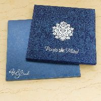 This stylish invitation card is made from rich color satin cloth of fine quality. Card front is covered with designer imprints, beautiful silver motif in the middle add a lot of zing to the appearance of this card.