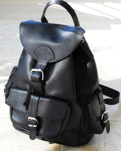 Leather backpack three pockets black