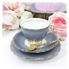 Find a nice cozy spot and enjoy the simple pleasure of a hot cup of tea in this stunningly elegant Colclough grey ballet English bone china tea set. An elegant and understated bone china tea trio produced during the 1950s by Colcloughs of the Regent Works, Longton, Staffordshire. Gold trim gleams brightly and adds that special elegance and charm to any table setting. This is a Colcloughs ballet set, recognisable by the white skirt at the base of teacups, the set is in the grey colour which…