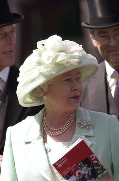 Queen Elizabeth II - I love her. She's fabulous ... Even with her ridiculous monochromatic outfits!