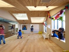 composed of volumes reminiscent of the archetypal house, each 'dwelling' functions as a classroom or playroom, their arrangement being much like that of a small neighbourhood.