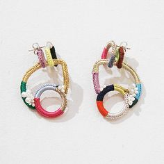 SHINGO MATSUSHITA. Repetition of shape unifies the earrings.