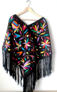 All black ponchos we had in stock are gone! Thank you :) But we are currently making seven of them!! Reserve your chic Huipil (poncho) with multicolor