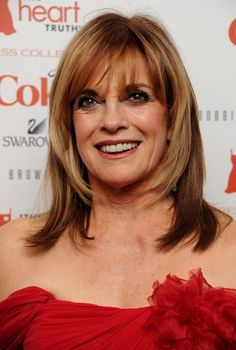 Bangs: 13 Ways To Wear Them Over 50 | 11. Linda Gray's Face-Framing Layers with Bangs | Style Goes Strong