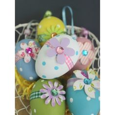 This fun set of 6 spotty egg decorations will make a wonderful decoration this Easter, each one has a tiny flower with a sparkling centre and is hung from silky ribbon. Hang artistically from a twig as an Easter tree or use as an alternative to chocolate eggs in an Easter egg hunt.  Find them at: http://www.pasttimes.com/gift_finder/by_occasion/easter_gifts/set_of_6_flower_polka_dot_hanging_eggs-870154.htm
