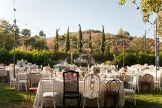 mismatched dining chairs  photo by Jessica Claire | VIA #WEDDINGPINS.NET