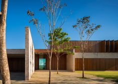 Casa MS features one brick and timber facade and another that is all glass