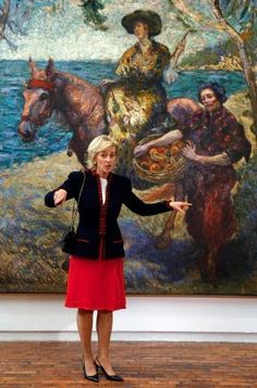 Belgium's Princess Astrid, gestures to the media as she poses for a photo during her visits to the Modern Art Museum of Bogota, in Bogota, Colombia, 19.10.2014. Princess Astrid arrived to Colombia for a four-day official visit.