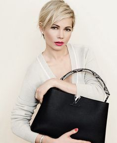 Michelle Williams is holding a  Louis Vuitton Black Capucine MM Handbag N91659 (Fall 2014). The first Louis Vuitton store opened on the rue des Capucines in Paris in 1854 ($6100)*