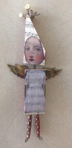 Mixed media Wood bead and bone doll