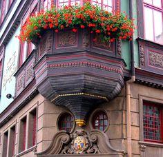 Ornate corner window box dressing up windows in beautiful old building in Eisenach, Germany