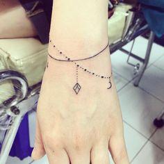 So so so madly in love with my first tattoo! #wristtattoos #wristtattoo #tattooedgirls #chiangmai #thailand #tats #tat #tattoo #tattoos #bambootattoo #bambootattoothailand Tiny Wrist Tattoos, Jewel Tattoo, Bamboo Tattoo, First Tattoo, Tattos, Girl Tattoos, Thailand, Tattoo Ideas, Jewels