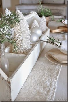 "White Christmas centerpiece ""trough"" paired with bleached woods and green. Pretty! / Buckets of Burlap"