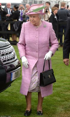The Queen arrives at the Cartier Queen's Cup at Windsor Great Park to present the trophy to the winning team