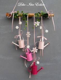 Window hanger with small watering cans . Four small watering cans, plus white ., Window hanger with small watering cans . Four small watering cans, plus white wood flowers and a little artificial. Small Watering Can, Wood Flowers, Spring Crafts, Easter Crafts, Wind Chimes, Fall Decor, Spring Decorations, Diy Home Decor, Diy And Crafts