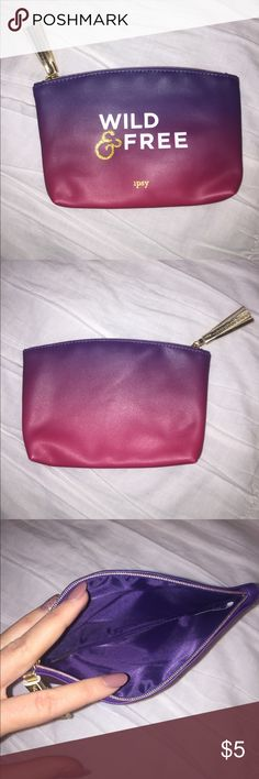 "Ombré Ipsy Bag Beautiful purple and pink ombré makeup bag with gold tassel zipper! This is so cute for holding makeup, keys, or jewelry! Has super cute white and gold ""wild and free"" writing on the front!💜  You can pick any cosmetic bag in my closet for FREE with any makeup purchase! Ipsy Bags Cosmetic Bags & Cases"