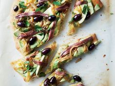 Avocado Pissaladière | Store-bought pizza dough makes quick work of this avocado-topped pissaladière, the classic Niçoise tart that features caramelized onions, anchovies and olives.