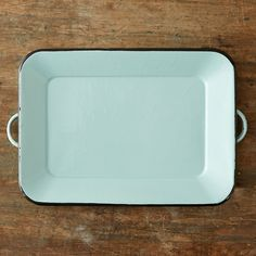 """Inspired by vintage finds, this enameled serving tray pairs a refreshing shade of mint with navy accents.- Brass, enamel finish- Hand wash- USA1.25""""H, 10.5""""W, 16""""L"""