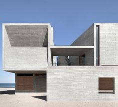 The architectural concept comprises concrete-clad walls and rectangular shapes with many angles.