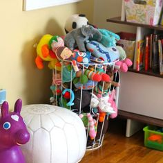 Getting Organized: 5 Tips to Help Organize Kids' Rooms - Corral stuffed animals in wire hamper.